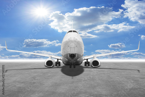 Fotografering  Passenger aircraft against blue sky background