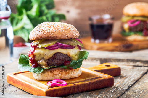 Fototapeta Burger with  gherkins, red onion and lettuce obraz