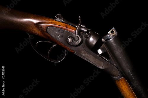 Fotografía Double-barreled shotgun on a black background