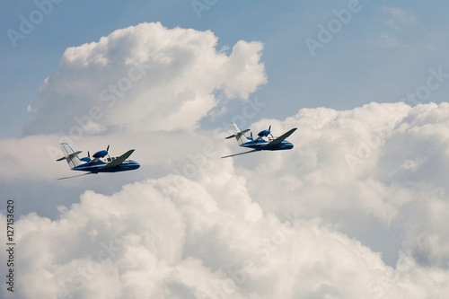 Foto  pair of the  Flying airplane Be-103 in clouds