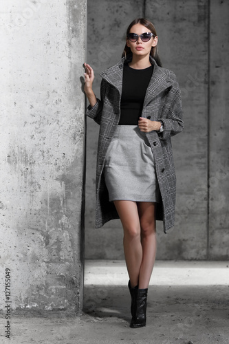 high fashion portrait of young elegant woman outdoor. Wall mural