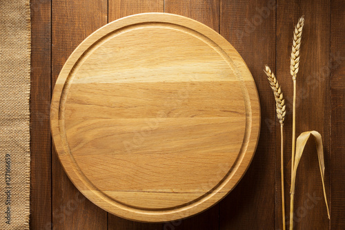 Fotografia, Obraz  ears of wheat and cutting board