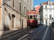 Street in Lisbon with tram passing