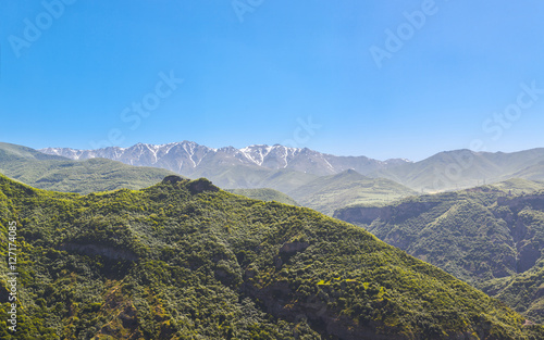 Poster Kaki Beautiful landscape with green mountains and magnificent cloudy sky. Exploring Armenia