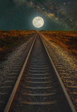 Railway Track With The Moon And Milky Way In Night Sky