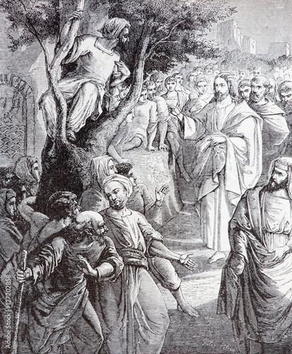 SEBECHLEBY, SLOVAKIA - JULY 27, 2015: The Christ Calling Zacchaeus  lithography by artist Scheuchl 1907 in the book Zivot Jezisa Krista bozskeho Spasitela naseho printed in Trnava Fototapeta