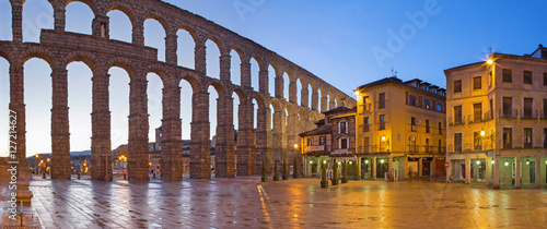 Canvas Prints Ruins SEGOVIA, SPAIN, APRIL - 13, 2016: Aqueduct of Segovia and Plaza del Azoguejo at dusk.
