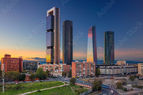 Poster Madrid Madrid. Image of Madrid, Spain financial district with modern skyscrapers during sunset.