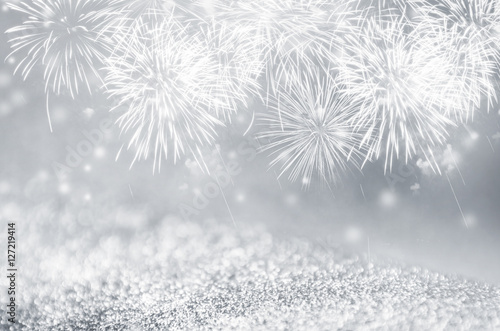 defocused silver and gray fireworks and bokeh on gliter paper at new year and copy space