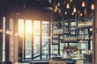 canvas print picture - modern loft style restaurant decoration with hanging light bulb beer pub and bar.