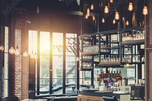 modern loft style restaurant decoration with hanging light bulb beer ...