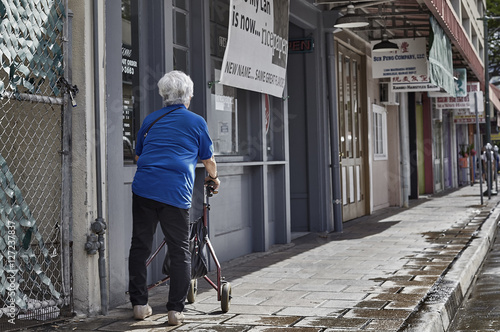 Person with walker aid on downtown Chinatown sidewalk