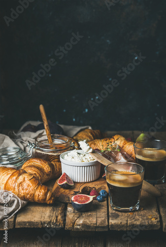 Fototapeta  Breakfast with croissants, ricotta cheese, figs, fresh berries, prosciutto meat,