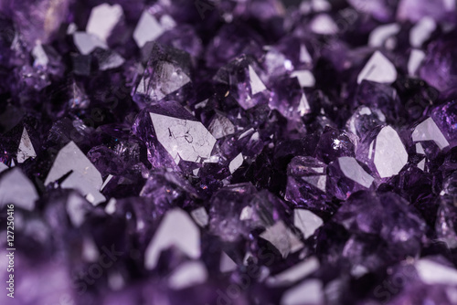 Amethyst geode on black background Wallpaper Mural