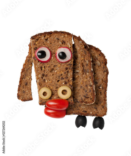 Sheep made of black bread and vegetables on white background