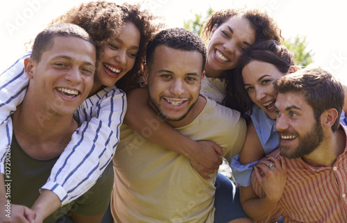 Fotografie, Obraz  Portrait of six young adult friends piggybacking outdoors