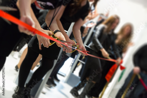 Fotomural store grand opening - cutting red ribbon