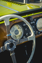 Vertical Photo Of The Steering Wheel And Wooden Board Of A Classic Morgan Convertible Sports Car Detail