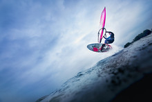High Jump Of A Windsurfer Over A Wave