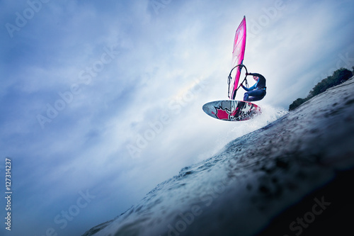 high jump of a windsurfer over a wave Canvas Print
