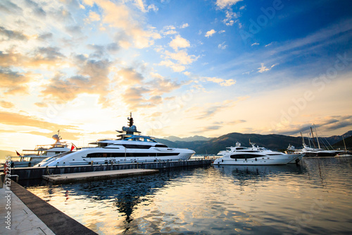 Fototapeta Luxury yacht marina. Port in Mediterranean sea at sunset.