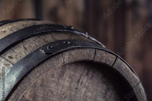 Wooden barel. Old wooden keg. Barel on beer vine whiskey brandy rum or cognac.