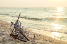 RUSTY ANCHOR WET BEACH SAND AN...