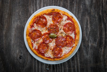Pizza Margarita With Cheese And Tomato Isolated On Rustic Wooden Table