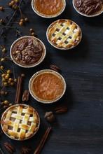 Top Down View Of 3 Different Pies - Apple Pie Pumpkin Pie And Pecan Pie