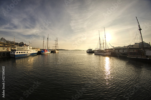 Photo  Boats in the Harbor at sunset