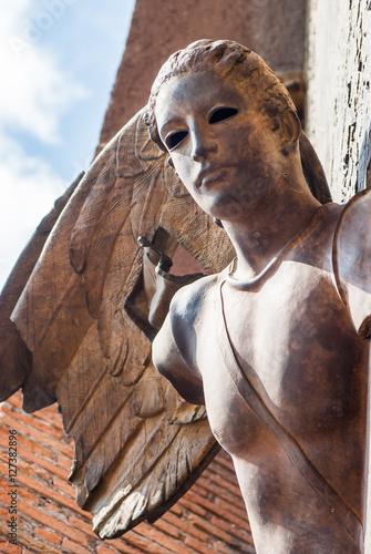 Fotografie, Obraz  Rome, Italy - September 10, 2012: Angel from gate of basilica Sa
