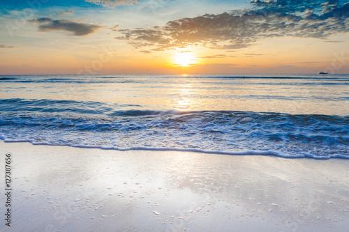 Fototapeta Bright sunrise over on the beach obraz na płótnie