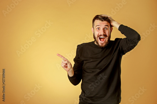 Fotografija  Portrait of young man with shocked facial expression