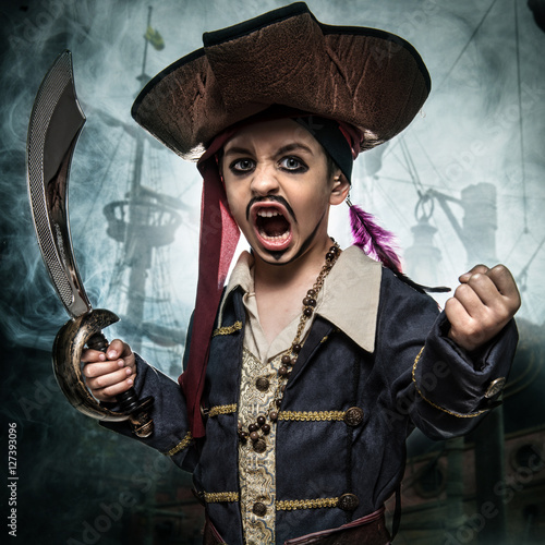 A angry young boy wearing a pirate costume Fototapeta