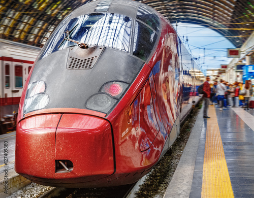 High-speed train at the railway station in Milano, Italy. Express ...