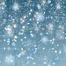 Blue Christmas And New Years Snow Background With Bokeh Sparks