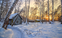 Abandoned Cabin In Winter Suns...