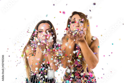 Obraz Happy young girls with confetti in a party - fototapety do salonu
