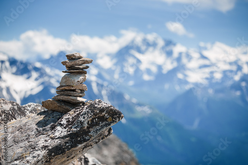 Leinwand Poster Stones cairn near Eggishorn peak in Swiss Alps