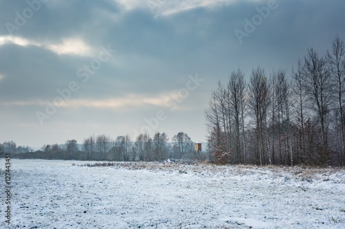 Fototapeten Natur Winter landscape with raised hide and snow covered countryside