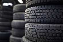 Tires For Sale At A Tire Store - Stacks Of Old Used Tires