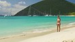bikini woman walking down a tropical beach, White Bay, Jost Van Dyke