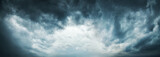 Fototapeta Na sufit - Dramatic Sky Background. Stormy Clouds in Dark Sky. Moody Cloudscape. Panoramic Image Can Be Used as Web Banner or Wide Site Header. Toned and Filtered Photo with Copy Space.