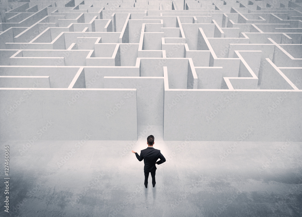 Fototapety, obrazy: Sales person standing at maze entrance