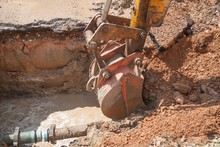 Excavator, Bulldozer Work A Hole The Repair Of Pipe Water