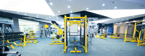 Fotobehang Fitness equipment in modern gym