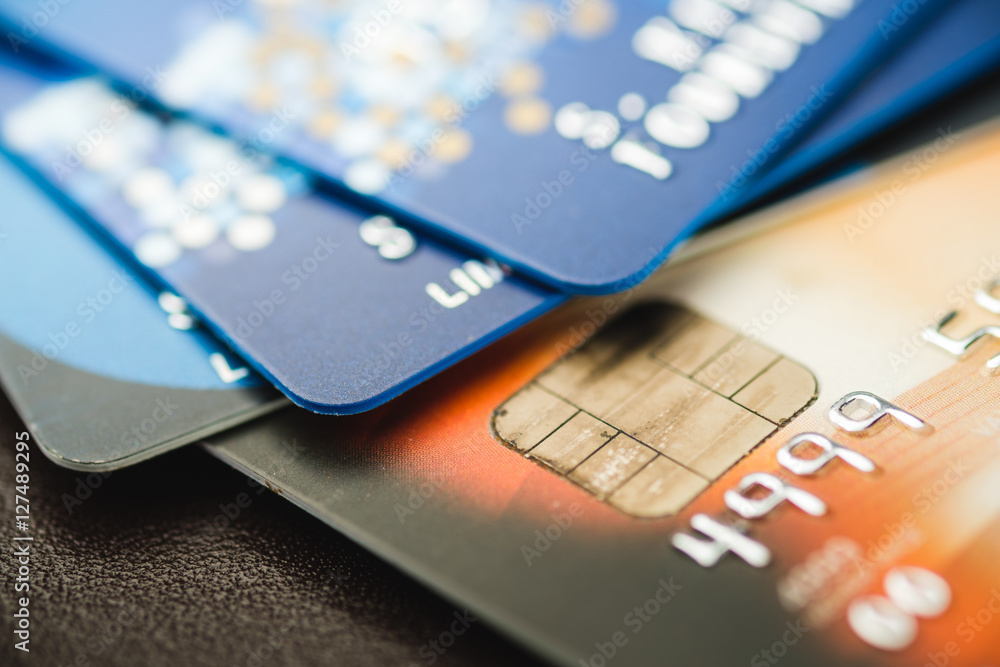 Fototapeta Credit cards stacked, old credit cards in brown and blue color
