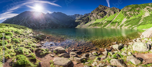 Foto op Plexiglas Pistache Panorama of sunrise at Czarny Staw Gasienicowy in Polish Mountains