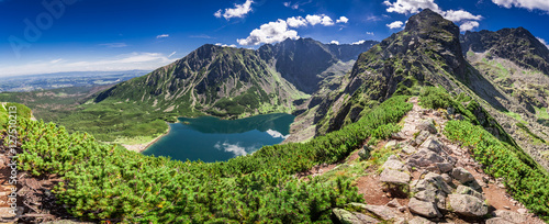Fotobehang Pistache Wonderful panorama of Czarny Staw Gasienicowy in Polish Mountains