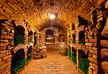 FototapetaSmall wine cellar with bottles and keg